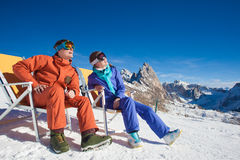 Two snowboarders on top of the mountain having fun Stock Images