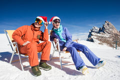 Two snowboarders on top of the mountain having fun Stock Photo