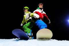 Two snowboarders wearing ski mask at night Stock Image