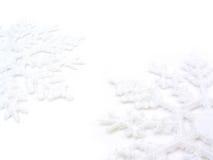 Two Snowflakes. White snowflakes on white background Stock Photos