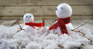 Two snowman with fake snow. Close-up of two snowman with fake snow 4k stock video footage