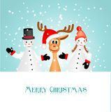 Two snowman figurines and funny reindeer Stock Images
