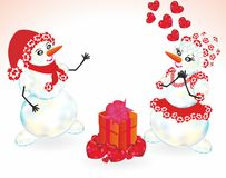Two snowman and gift Royalty Free Stock Photography