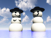 Two Snowman On Holiday In The Water 25. A computer created Christmas scene of a happy snowman and snowwomen in some tropical water on holiday Royalty Free Stock Images