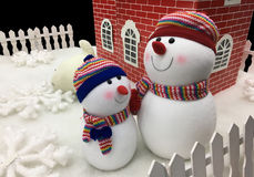 Two snowman and home Stock Image