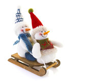 Two Snowman on a sledge Royalty Free Stock Photography