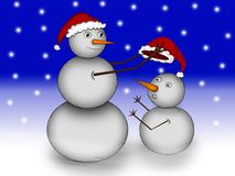 Two snowman in the snow at night Royalty Free Stock Images