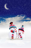 Two snowman in snow Royalty Free Stock Photography