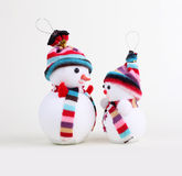 Two snowman on white Royalty Free Stock Photos