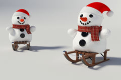 Two snowman,and wooden sleds with him Stock Image