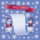 Two Snowmans and the inscription MERRY CHRISTMAS! Stock Photo