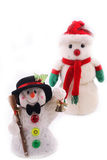 Two Snowmen. Standing in a row for Christmas collection over white background Stock Photography