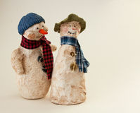 Two Snowmen Buddies. Hand-sculpted papier mache snowmen buddies with hats and scarves Royalty Free Stock Photography