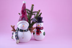 Two snowmen and a fir tree Stock Images