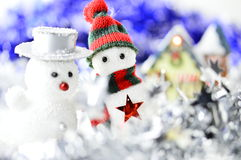 Two snowmen in front of a house Stock Photo