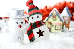 Two snowmen in front of a house Royalty Free Stock Photography
