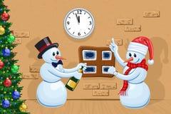 Two snowmen. Two funny snowmen celebrate New Year Royalty Free Stock Photo
