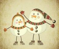 Two snowmen on grunge background Stock Image