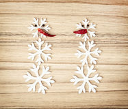Two snowmen made of snow flakes and chili peppers, symbol of win Royalty Free Stock Photo