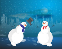 Two snowmen. Met on the night street Stock Photography