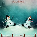 Two snowmen and music Royalty Free Stock Photography
