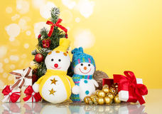 Two snowmen near the Christmas tree and toys Royalty Free Stock Photos
