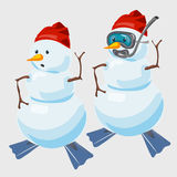 Two snowmen in red cap and with fins diver Royalty Free Stock Photos