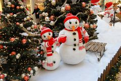 Two snowmen in shopping center. stock photo