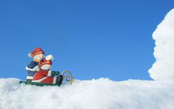 Two snowmen on sledge Royalty Free Stock Image