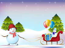Two snowmen and sleds Royalty Free Stock Photos