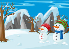 Two snowmen on the snow field Royalty Free Stock Photography