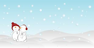 Two snowmen in the snowdrifts Royalty Free Stock Image