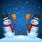 Two snowmen stand with broom Royalty Free Stock Photo