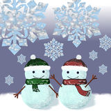 Two snowmen are standing under snowflakes Stock Photos