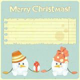 Two snowmen on vintage background Royalty Free Stock Photo