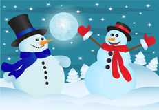 Two snowmens. Two snowmen in the night sky and the snow-covered forest Royalty Free Stock Image
