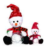 Two snowmens in santa hat of the winter Stock Photography