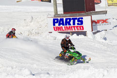 Two snowmobiles coming to finish line Stock Photo