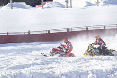 Two Snowmobiles Racing Royalty Free Stock Image