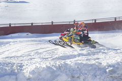 Two Snowmobiles Racing Neck and neck. EAGLE RIVER, WI - MARCH 2:  Two Snowmobiles Racing neck and neck during a race on March 2, 2013 in Eagle River, Wisconsin Stock Photography