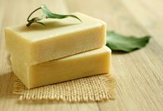 Two soap and green leaf on wooden Royalty Free Stock Photo