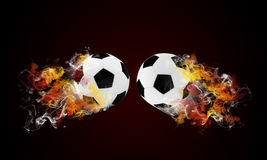 Two soccer ball in the color of flame and smoke Stock Images