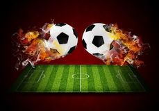 Two soccer balls in the color of flame and smoke Royalty Free Stock Photo