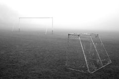 Two soccer gates in mist royalty free stock photography