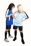 Two soccer girls with ball. Stock Images