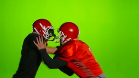 Two soccer players face in battle and divergent. Slow motion. Two football players face each other in battle and diverging in different directions. Slow motion stock footage
