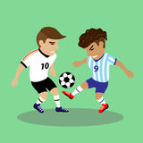 Two soccer players fighting for a ball Royalty Free Stock Photo