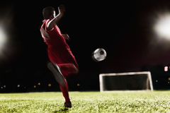 Two soccer players kicking a soccer ball at game stock photography
