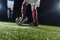 Two soccer players kicking a soccer ball Royalty Free Stock Images