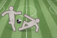 Two soccer players strike on the field Royalty Free Stock Photography